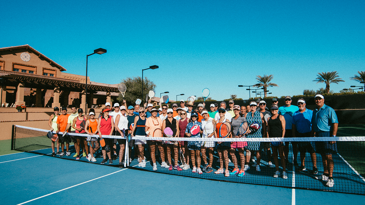 Large group of pickleball and tennis players